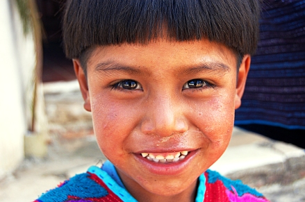 A Mayan boy smiles in Chamula, Mexico. Chamula is one of the few indigenous Maya villages within the Mexican state of Chiapas where foreigners are allowed to enter. (PHOTO BY RACHEL METEA)